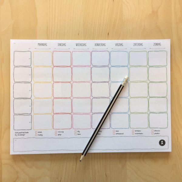 gezinnig weekplanner notitieblok optafel